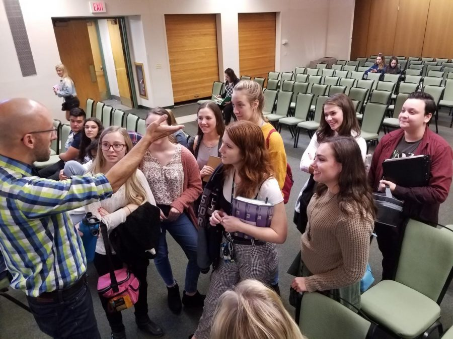 Mike Simons, left, chats with student journalists after delivering his Keynote session at the Garden State Scholastic Press Association's Fall Press Day on Oct. 28 at Rutgers University's Busch Campus Center.